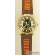 Bulova 17J vintage mechanical movement wrist watch, heavy yellow gold filled & stainless steel round water resistant case, black dial