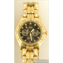 Guess vintage quartz wrist watch with day and date, yellow gold plated & stainless steel cushion-shaped water resistant case, black dial